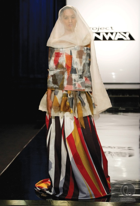 "In the ""Fashion as Art"" challenge for Project Runway, Patricia created a dress complete with a white veil (very reminiscent of Alexander McQueen and Vivienne Westwood) to obscure the model's face, making her androgynous. Her hands are constricted and immobile because she is portraying a woman who, according to Patricia, has lost her identity (every garment has a story behind it). (Photo courtesy of Lifetime)"