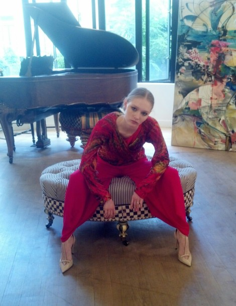 "Young model, Essdea wears a Carter Smith design while lounging in front of Vicky Barranguet's ""Time Flow"""